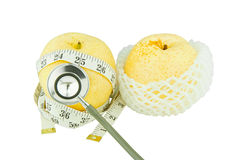 Pear measured the meter, weight loss concept Stock Images
