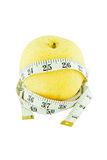 Pear measured the meter isolated on white, weight loss concept Royalty Free Stock Photography
