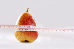 Pear and measurement tape symbol Stock Image