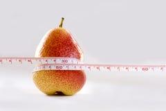 Pear and measurement tape symbol stock image