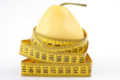 Pear with a measuring tape Royalty Free Stock Image