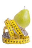 Pear and measuring tape. Royalty Free Stock Photography