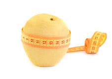 Pear with a measuring tape Royalty Free Stock Photos