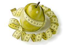 Pear and measuring tape Royalty Free Stock Image