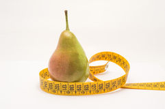 Pear with measuring tape isolated Royalty Free Stock Photos