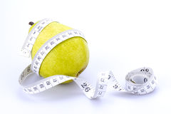 Pear and measuring tape Stock Photo
