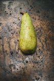 Pear on metal surface Stock Image