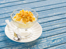 Pear with natural yoghurt, corn flakes and honey - a delicious dessert, breakfast or snack . Stock Photography