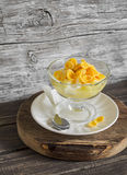 Pear with natural yoghurt, corn flakes and honey - a delicious dessert, breakfast or snack . Royalty Free Stock Photos