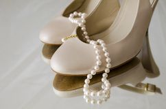 Pear necklace and shoes Stock Image