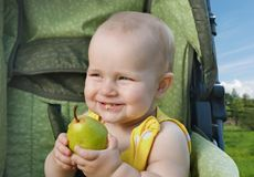 Pear-nursery pleasure. It is necessary for small children to eat fresh fruit and vegetables! Vitamins stimulate correct development and growth of the child Royalty Free Stock Photography