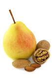 Pear and nuts. Sweet pear and tasty nuts stock photos