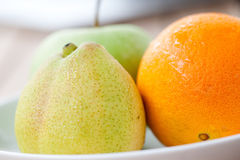 Pear, an orange and a green apple Stock Photography