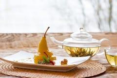 Pear in orange juice with herbal tea Royalty Free Stock Photo
