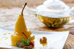 Pear in orange juice with herbal tea Royalty Free Stock Photography