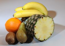 Pear, orange, kiwi, pineapple and banana compositon. Stock Photography