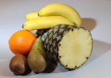 Pear, orange, kiwi, pineapple and banana compositon. Stock Photography