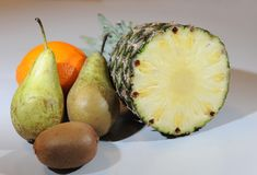 Pear, orange, kiwi, pineapple compositon. Royalty Free Stock Image