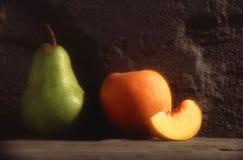 Pear and peach Stock Photos