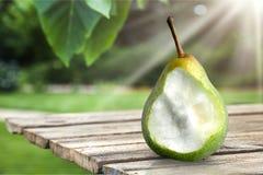 Pear. Evolution change fruit missing bite image sequence progress Royalty Free Stock Images