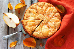 Pear pie. Homamade pie with fresh pears over natural wood background Stock Photography