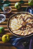 Pear pie with nuts, caramel and mascarpone stock photo