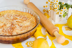 Pear pie. Sweet yellow homemade pear pie on white background royalty free stock image