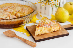 Pear pie. Sweet yellow homemade pear pie on white background stock photo