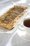 Pear pie with tea Stock Image