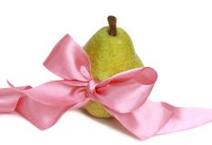 Pear and pink ribbon Royalty Free Stock Images