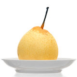 Pear on plate Royalty Free Stock Photo