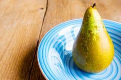 Pear on plate Stock Photos