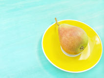 Pear on a plate Stock Photos