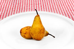 Pear on plate Stock Images