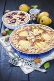 Pear and plum frangipane tarts Royalty Free Stock Photos