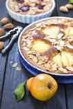 Pear and plum frangipane tarts Stock Photos
