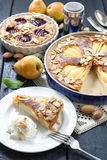 Pear and plum frangipane tarts Stock Image