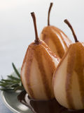 Pear Poached with Rosemary and a Chocolate sauce Royalty Free Stock Image