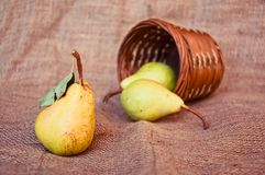 Pear and punnet Royalty Free Stock Image
