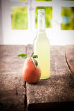 Pear with pure squeezed juice Royalty Free Stock Image
