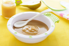Pear puree for baby nutrition Stock Images
