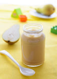 Pear puree in jar for baby nutrition Royalty Free Stock Photos