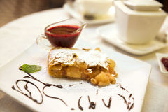 Pear and raisins strudel with berry sauce Stock Photos
