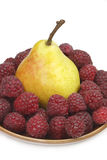 Pear and raspberries Stock Photo