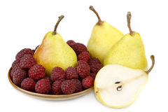 Pear and raspberries Stock Photos