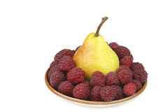 Pear and raspberries stock photography