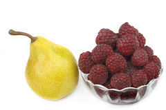 Pear and raspberries Stock Image