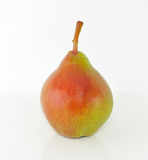 Pear red and green on a white background. Pear red and green on a white background with reflection Royalty Free Stock Image