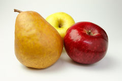 Pear and red and yellow apple Stock Images