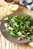 Pear in a salad with balsamic dressing Stock Photo